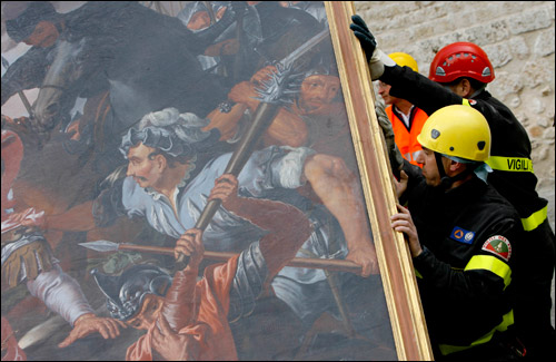 "Firefighters carry ""The Battle of Celestino V"" painting rescued from the damaged Collemaggio's Basilica, in L'Aquila, Italy, Wednesday. The region in central Italy ravaged by an earthquake more than a week ago will need at least $16 billion for rebuilding.   AP Photo by Alessandra Tarantino"