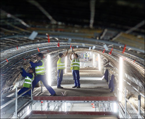 Workers perform restoration work on the Channel Tunnel off Coquelles, France, Dec. 10. May 6 marks 15 years since the chunnel, as it is commonly called, opened for service between France and England.  AP Photo by Michel Spingler