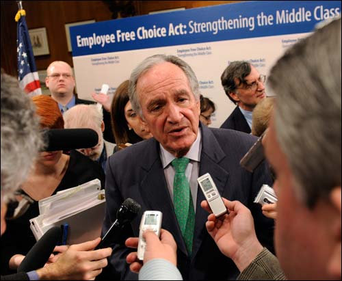 Sen. Tom Harkin, D-Iowa talks to reporters on Capitol Hill in Washington on March 10 after a news conference to announce the introduction of the Employee Free Choice Act. Although the so-called card-check bill later appeared dead, Sen. Arlen Specter, D-Pa., now says he supports a version of the measure and predicts it will pass. AP Photo by Susan Walsh