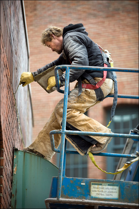 Marshall Morford of Holton Brothers Inc., Grafton, restores masonry on a building at North Martin Luther King Jr. Drive and West McKinley Avenue in Milwaukee. (Photo by Dustin Safranek)