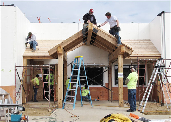 Dozens of volunteers help build wisconsin church the for Help me build a house