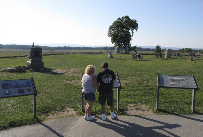 Tourists Sandy and Brian Augustine of East Freedom, Pa., read about Pickett's Charge at Gettysburg National Military Park on Monday in Gettysburg, Pa. Some preservationists worry that a plan to build a casino near the park, if successful, would cheapen the sacrifice of the soldiers who died in the 1863 Civil War battle and ruin the area's wholesome reputation that draws tourists. (AP Photo/Marc Levy)