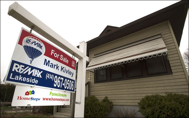 A foreclosed home sits for sale Thursday at 2454 Wauwatosa Ave. in Wauwatosa. Home sales (Staff photo by Kevin Harnack)