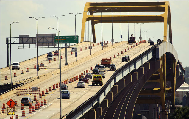 Traffic passes over the Hoan Bridge on Monday in Milwaukee. Bicyclists want the state Department of Transportation to include a pedestrian and bike path in the reconstruction of the bridge. (Staff photo by Kevin Harnack)