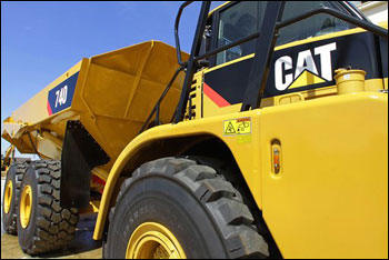 The Caterpillar logo is seen on heavy earth-moving equipment in Springfield, Ill. Caterpillar Inc. (AP File Photo/Seth Perlman)