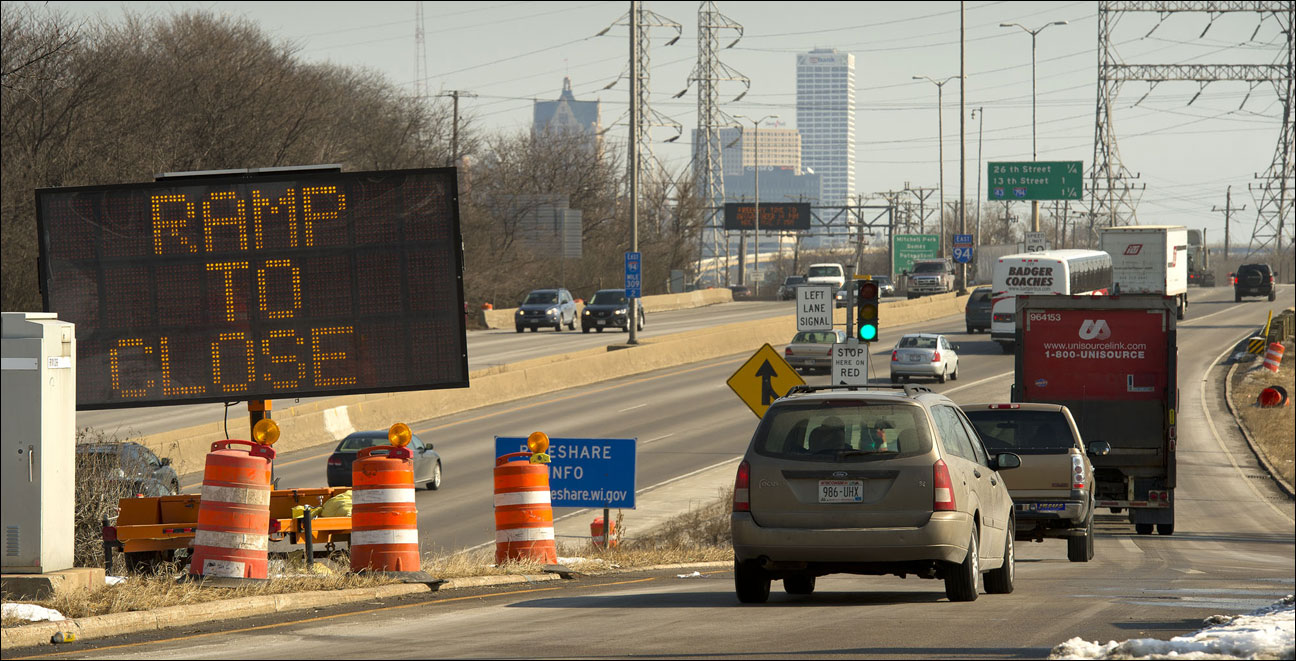 Traffic passes a sign noting upcoming construction while heading towards Interstate 94 from the 35th Street on ramp Monday, Feb. 25 in Milwaukee. Work on the freeway between 27th Street and 35th Street is slated to begin next Monday. (Staff photo by Kevin Harnack)
