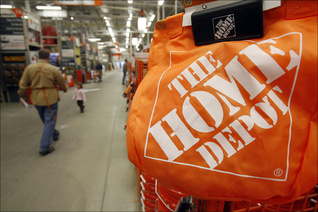 shoppers and sales representatives walk through the aisles at the Home Depot store in Williston, Vt. Home Depot's second-quarter net income jumped 18 percent as surging home sales drove comparable-store sales up by double digits at home and abroad, according to reports Tuesday, Aug. 20, 2013. (AP Photo/Toby Talbot, File)