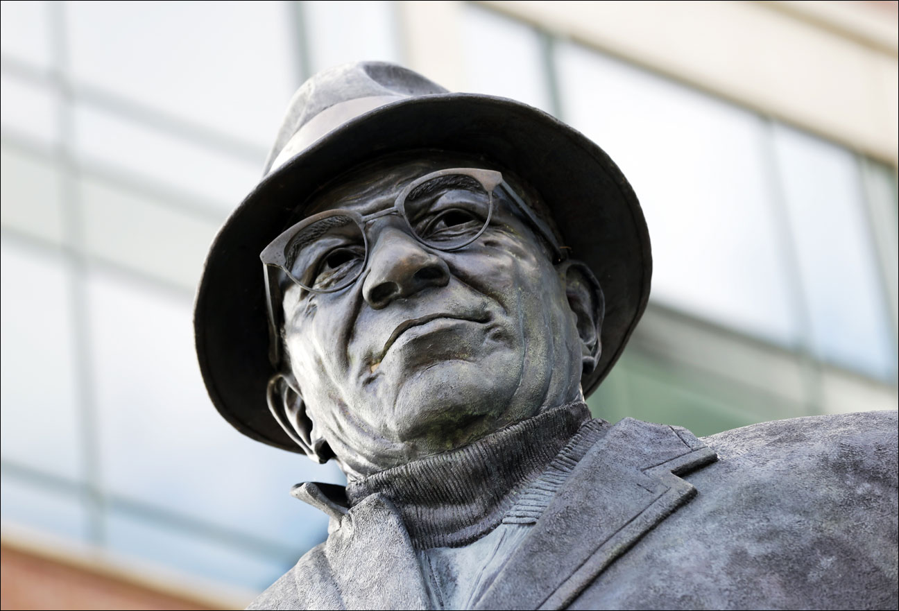 A statue of Vince Lombardi is seen outside Lambeau Field before an NFL football game between the Green Bay Packers and the Philadelphia Eagles Sunday, Nov. 10, 2013, in Green Bay, Wis. (AP Photo/Mike Roemer)