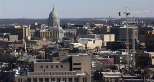 Wisconsin State Capitol and downtown Madison skyline as seen from the upper floors of the Van Hise Building on the campus of UW-Madison. A wind child warning is in effect until noon. Temperatures are in double digits below zero across the state. Sparta's temperature is 27 below, without the wind chill. In Antigo, it's 22 below and Kenosha is 12 below. (AP Photo/Wisconsin State Journal, John Hart)