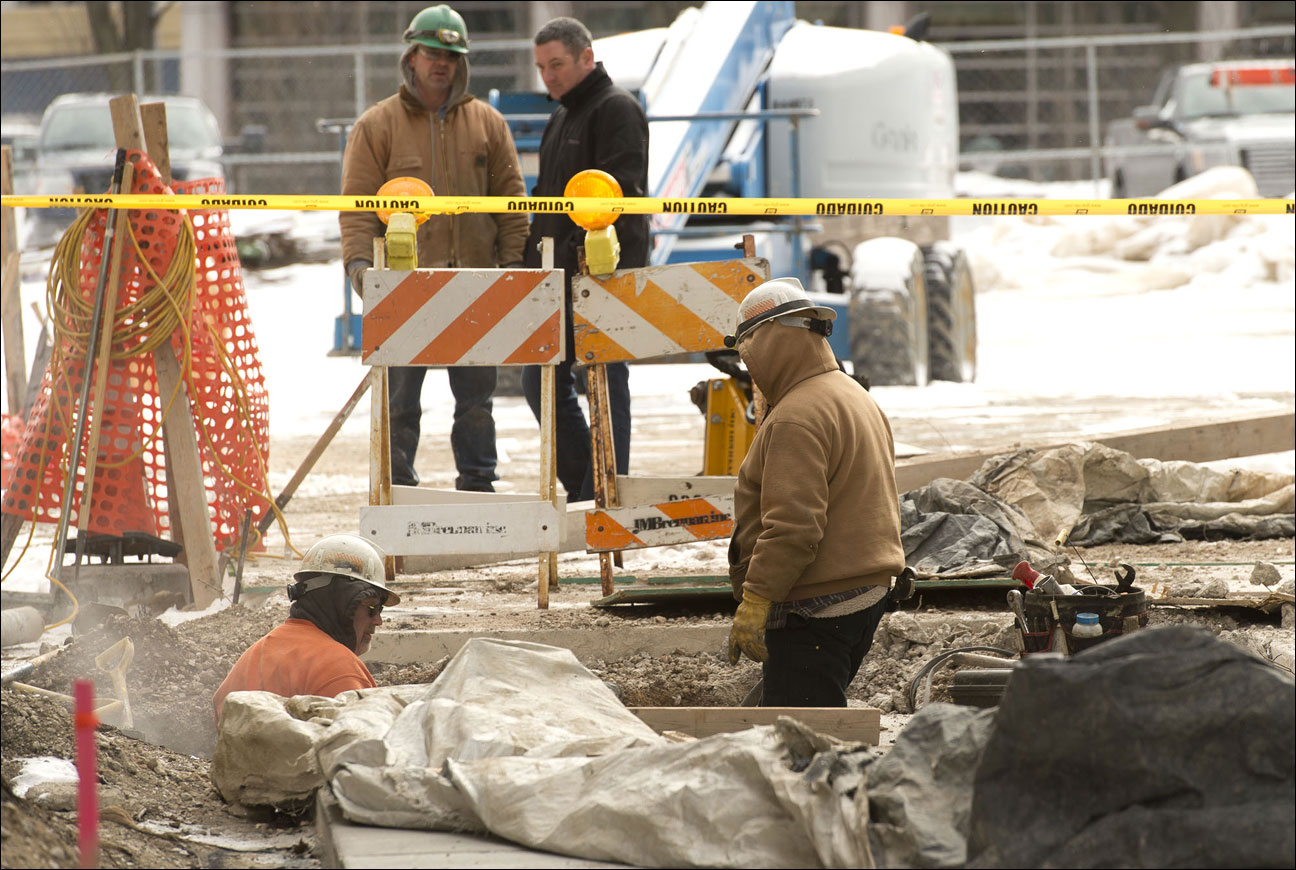 Crews work to clean up after securing a gas leak Wednesday, Jan. 15 on the Marquette University campus in Milwaukee. A construction crew hit a gas line near Johnston Hall on campus and the leak was sealed by about 12:45 p.m. (Staff photo by Kevin Harnack)