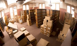 The Office of the City Attorney's former law library (above) on the eighth floor of Milwaukee City Hall is empty Friday except for books and old files, and a note (left) indicates which bookshelves are to be saved. The office's 2015 capital improvements request to continue renovating the eighth floor so attorneys can move back in has rekindled a disagreement among aldermen about the use of the former library. (Staff photos by Kevin Harnack)