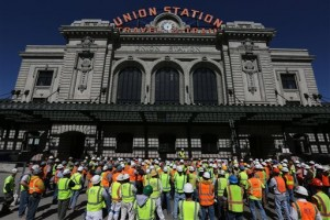 Construction workers gather listening to a safety talk by a manager in front of Union Station, which is undergoing an extensive renovation and expansion, in Denver, on Monday, April 8, 2014. After laying off two million workers during the recession, the construction industry now fears it may not have enough crews to keep up with demand for building projects. On April 8, 2014 in Denver, the Associated General Contractors of America announced a plan to deal with the shortage, including establishing charter schools focused on technical training, starting non-union apprenticeship programs and calling on Congress to pass immigration reform. (AP Photo/Brennan Linsley)