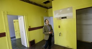 George Limperis, a realtor with Paragon Real Estate Group, walks through the kitchen of a property in the Noe Valley neighborhood in San Francisco. On Thursday, Aug. 21, 2014, the National Association of Realtors is scheduled to report on existing-home sales in July 2014. (AP Photo/Jeff Chiu, File)