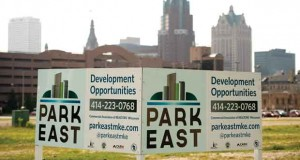 The Milwaukee skyline stands beyond a sign posted for vacant land on the Park East site. (File photo by Kevin Harnack)