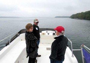researchers, government officials and members of the Green Lake Association, take a boat tour of Green Lake , the state's deepest natural lake near Green Lake, Wis. A coalition of agencies are taking a proactive approach in an attempt to ward off increasing levels of phosphorous in Green Lake that has caused bands of dissolved oxygen. Anglers are also concerned about the lake, known for its lake trout, cicso and blue gill populations. (Barry Adams/Wisconsin State Journal via AP)