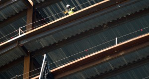 A construction worker inspects safety cables atop the Northwestern Mutual Tower project on April 14 in Milwaukee. A report issued Monday by the Milwaukee-based Public Policy Forum found that more could be done to employ local workers on projects like the one at Northwestern Mutual. (Staff photo by Kevin Harnack)