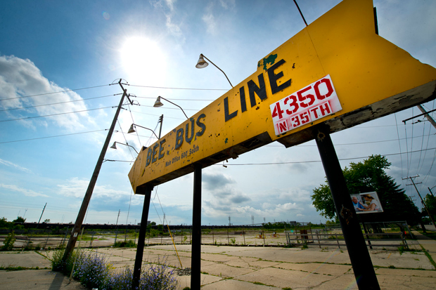 A sign for the former Bee Bus Line stands among vacant lots on Thursday in Milwaukee. The Milwaukee Metropolitan Sewerage District is building three basins in the area to control flooding in Milwaukee's 30th Street Industrial Corridor. (Staff photo by Kevin Harnack)
