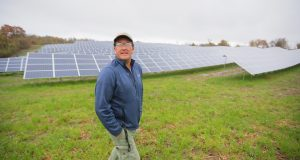 James Wagoner, construction supervisor at Innovative Power Systems, gives a tour of a new community solar garden at 450 Goodhue St. N. in Red Wing. (Staff photo: Bill Klotz)