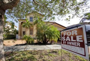 FILE - This Wednesday, Dec. 7, 2016, file photo shows a house for sale, in Hialeah, Fla. U.S. homes prices rose steadily upward in February 2017 as more homebuyers chased fewer available properties. The Standard & Poor's CoreLogic Case-Shiller national home price index increased 5.8 percent in February, the most in 32 months. (AP Photo/Alan Diaz, File)
