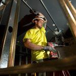 Dairyland Energy Solutions' Sebastian Borchardt hangs conduit.