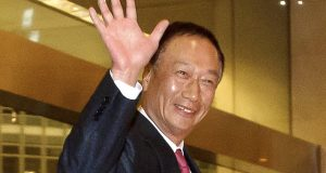 Terry Gou, Foxconn Technology Group chairman, waves as he arrives at a hotel in Beijing in February 2013. (AP Photo/Andy Wong, File)