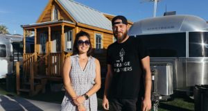 Jennifer Taler and Brad Johnson show off their tiny home in Las Vegas recently. In downtown Las Vegas, what started about three years ago as Zappos CEO Tony Hsieh's experiment of about 30 Airstream trailers and tiny homes, has turned into a community that is now called Fergusons Downtown. (Mikayla Whitmore/Las Vegas Sun via AP)