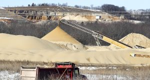 A dump truck hauls a load of sand on Thursday from the Sand Products of Wisconsin mine near Whitehall to a processing and loading operation. Wisconsin's frack-sand industry has come roaring back from a slump that idled mines two years ago, fueled by a continued surge in domestic crude-oil production.(Erik Daily/La Crosse Tribune via AP)