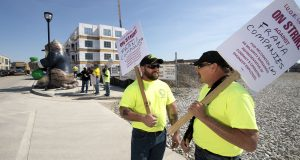 Leroy Miller (left) and Jim Dewar, both members of the International Union of Operating Engineers Local 139, picket outside The Waters of Oak Creek senior-living center on Tuesday. The union decided to protest because it is seeking recognition from the general contractor Frana Companies, of Hopkins, Minn., as the majority representative of the operating engineers working on the project. (Staff photo by Kevin Harnack)