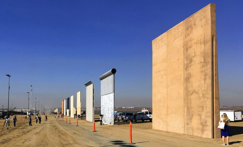 Prototypes of border walls stand in San Diego in October 2017. A federal appeals court will hear arguments by the state of California that the Trump administration overreached by waiving environmental reviews to speed up the construction of the president's prized wall along the Mexican border. (AP Photo/Elliott Spagat, File)