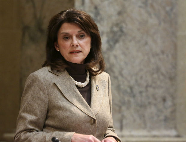 Wisconsin state Sen. Leah Vukmir stands in Wisconsin's Senate chambers in Madison in November. Vukmir, a Wisconsin state senator and close ally of Gov. Scott Walker's, says she has reached out to Richard Uihlein, a big Republican donor who backed her opponent in the primary, but has yet to learn how much support he will give her campaign. (Michelle Stocker/The Capital Times via AP, File)