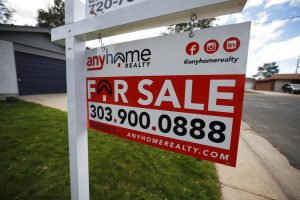 FILE- In this Oct 2, 2018, photo a for sale sign stands outside a home on the market in the north Denver suburb of Thornton, Colo. On Tuesday, Oct. 30, the Standard & Poor's/Case-Shiller 20-city home price index for August is released. (AP Photo/David Zalubowski, File)
