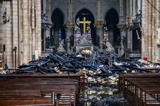 Debris lies inside Notre Dame cathedral in Paris following a catastrophic blaze on Monday. Historians and restorers are just beginning to discuss how the cathedral might be rebuilt, a job that's likely to take years, if not decades. (Christophe Petit Tesson, Pool via AP)