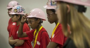 Wearing hard hats, girls attending in the National Association of Women in Construction's Camp NAWIC MKE 2019 go on a tour of The Southeast Wisconsin Carpentry Training Center/North Central State Regional Council of Carpenters in Pewaukee. (Photo by Kevin Harnack)