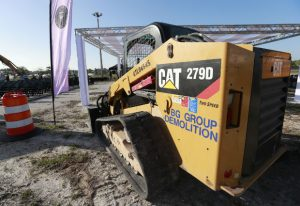 A Caterpillar 279D Compact Track Loader sits at a demolition site on May 8 in Fort Lauderdale, Florida. Caterpillar Inc. reported on Wednesday it had earnings of $1.62 billion, or $2.83 a share, in the second quarter.. (AP Photo/Wilfredo Lee)