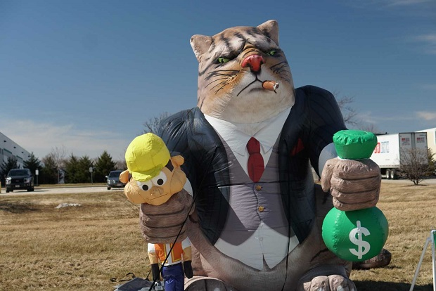 "A ""fat cat"" inflatable figure stands at a work site in West Allis in March 2018. Local 139 of the International Union Operating Engineers has been using this figure and similar ones this past year to protest the equipment rental company Sunbelt Rentals' refusal to negotiate with workers who wanted to unionize."