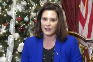 Michigan Gov. Gretchen Whitmer speaks about her first year in office and what is ahead during a meeting with reporters on Wednesday. Whitmer is working on a roads plan after the Legislature rejected her proposal for a 45-cents-a-gallon fuel-tax increase. (AP Photo/David Eggert)