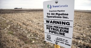 A sign stands on Jan. 9 to mark the presence of a buried oil pipeline under a corn field in rural Milford, Nebraska. (AP Photo/Nati Harnik)