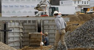 Construction continues at a housing plan on March 18 in Zelienople, Pennsylvania. Spending on U.S. construction projects fell 1.3% in February. The Commerce Department said the February decline followed a 2.8% rise in construction in January.  (AP Photo/Keith Srakocic)
