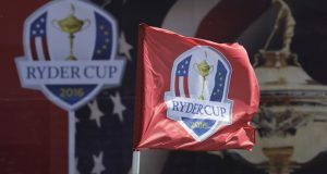 FILE - This Sept. 26, 2016, file photo shows a flag blowing in the wind before the Ryder Cup golf tournament at Hazeltine National Golf Club in Chaska, Minn. The Ryder Cup was postponed until 2021 in Wisconsin because of the COVID-19 pandemic that raised too much uncertainty whether the loudest event in golf could be played before spectators. The announcement Wednesday, July 8, 2020, was inevitable and had been in the works for weeks as the PGA of America, the European Tour and the PGA Tour tried to adjust with so many moving parts.(AP Photo/Charlie Riedel, File)