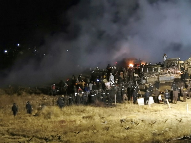 Morton County Sheriff's Department, law enforcement and protesters clash in November 2016 near the site of the Dakota Access pipeline in Cannon Ball, North Dakota A federal judge sided on Monday with the Standing Rock Sioux Tribe and ordered the Dakota Access pipeline to shut down until more environmental review is done. (Morton County Sheriff's Department via AP, File)