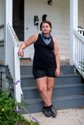 Amy Moreland stands outside her house in Madison, Wis., on June 14, 2020. Moreland is jobless while the bar where she previously worked is closed amid the COVID-19 pandemic. (Will Cioci / Wisconsin Watch)