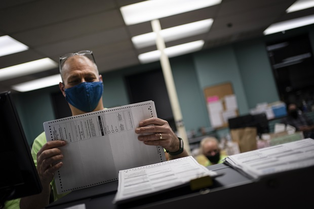 Poll workers sort out early and absentee ballots at the Kenosha Municipal building on Election Day on Tuesday in Kenosha. (AP Photo/Wong Maye-E)