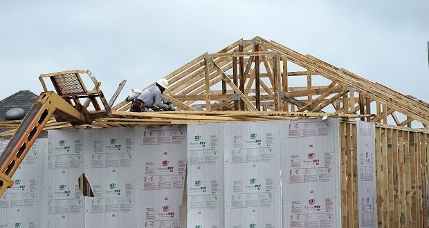 A new home under construction in Houston on Sept. 24.  The number of newly issued permits to build fresh housing rose 6.2% in November. Housing starts rose 1.2%, and are up 12.8% higher than a year ago, the Commerce Department reported Thursday to an annualized rate of 1.547 million. (AP Photo/David J. Phillip, File)