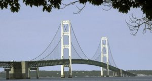 The Mackinac Bridge that spans the Straits of Mackinac from Mackinaw City, Michigan, in July 2002. Michigan's environmental agency said on Friday that it had approved the construction of an underground tunnel to house a replacement for a oil pipeline in the channel linking lakes Michigan and Huron. (AP Photo/Carlos Osorio, File)