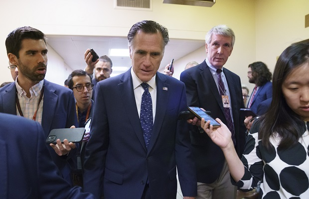 Sen. Mitt Romney, R-Utah, is surrounded by reporters as he walks to the Senate chamber for votes, at the Capitol in Washington on Thursday. Romney is working with a bipartisan group of 10 senators negotiating an infrastructure deal with President Joe Biden. (AP Photo/J. Scott Applewhite)