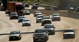 Vehicles travel the Beltline Highway on Madison's southwest side in July 2018. State officials continue to look for ways to raise money to pay for needed road projects throughout the state. (File photo by Kevin Harnack)